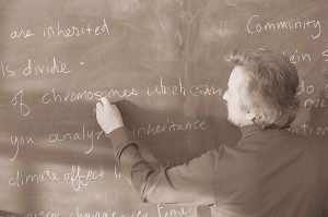 Science Teacher Writing on Black Board